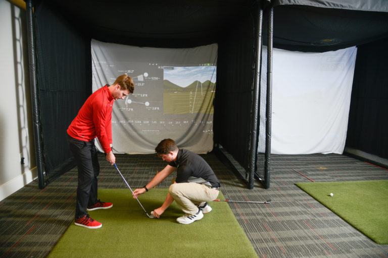 Nick and Scott in Player Development, practicing swing motion.