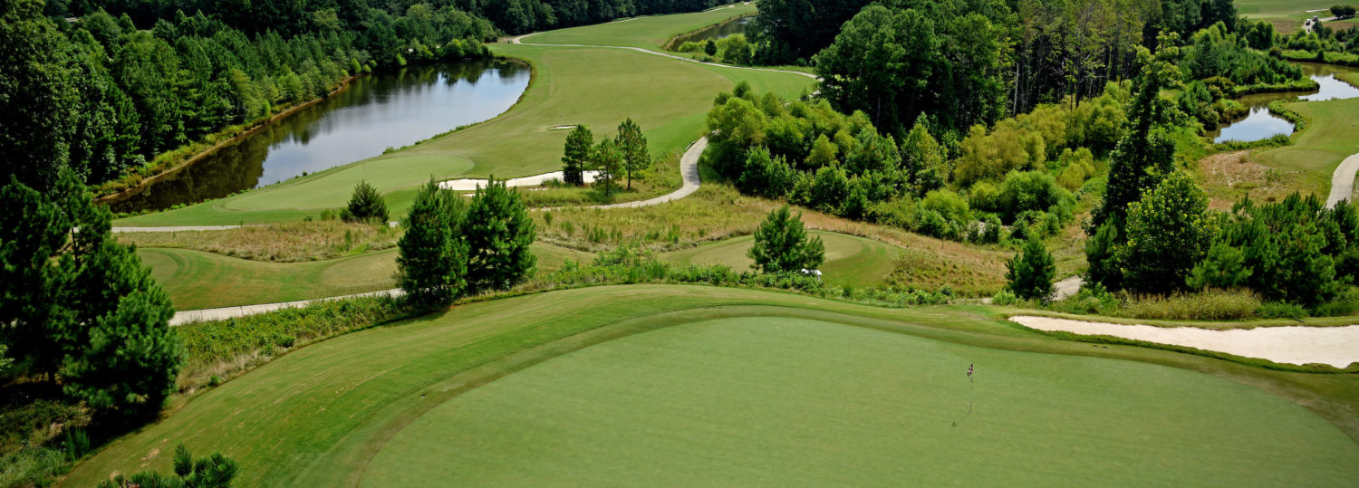 Lonnie Poole Golf Course, with Raleigh skyline in the distance.