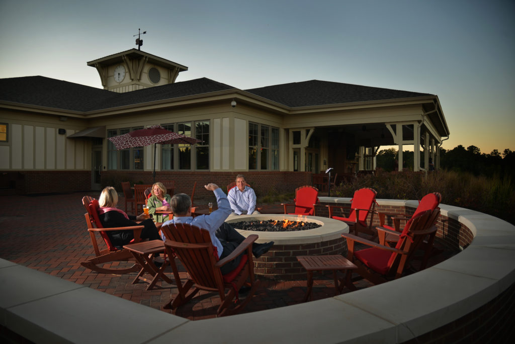 A group relaxes around the outdoor fire pit at the Terrace Dining Room.